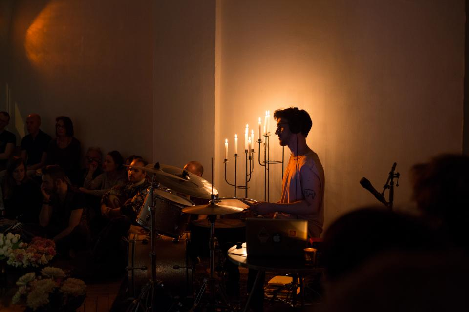 drummer in front of candles