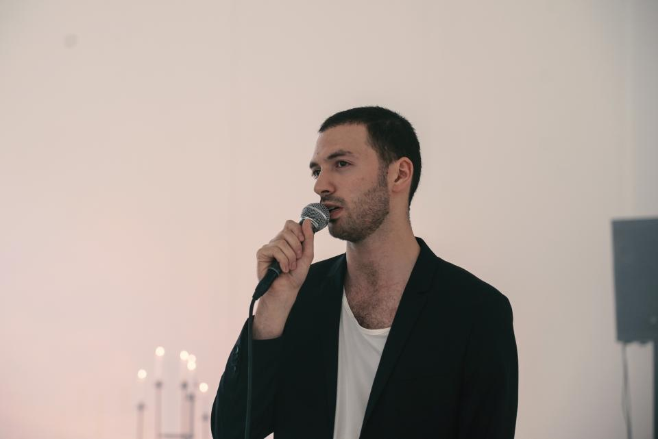 artist speaking into microphone